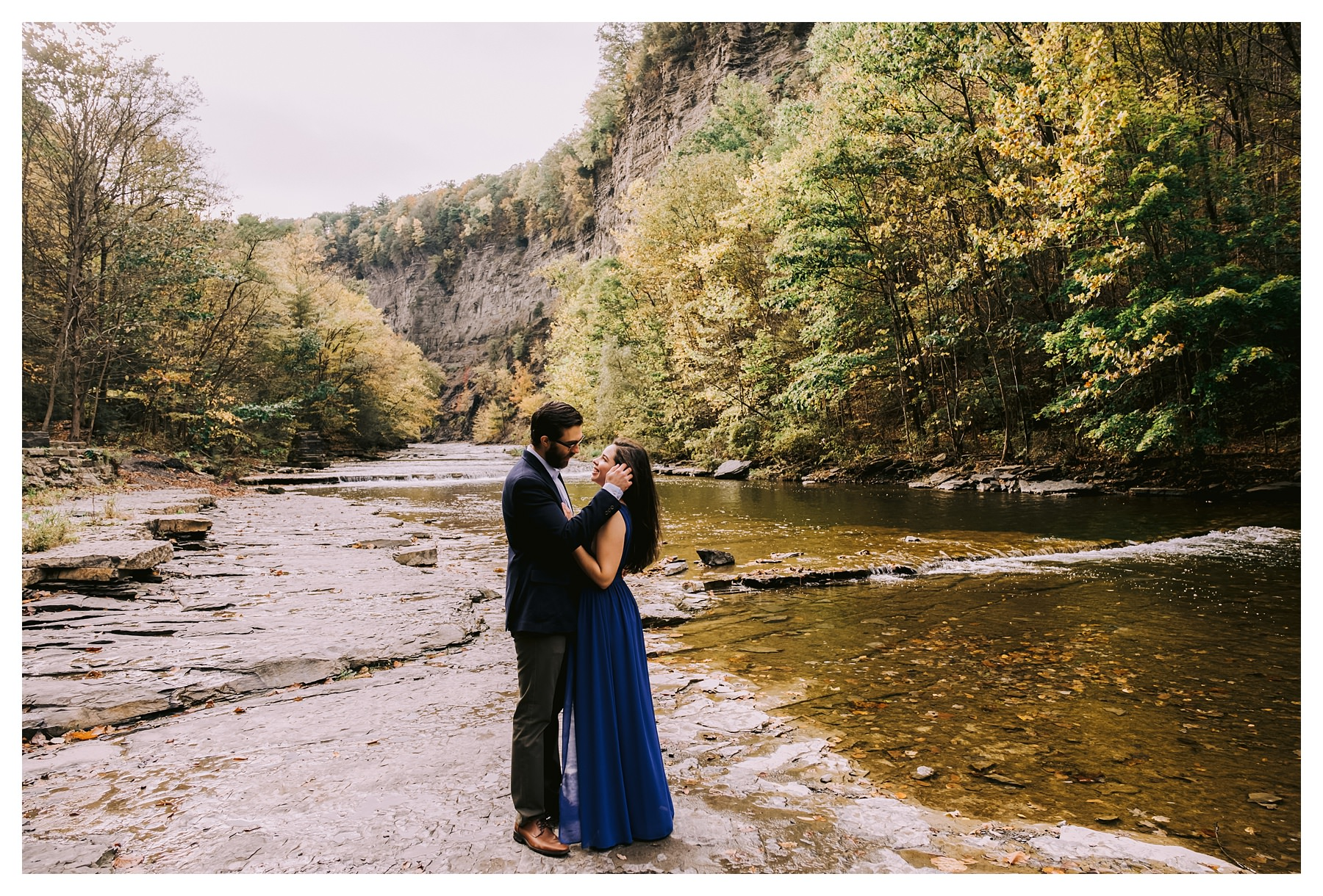 taughannock falls engagement session brushing hair back