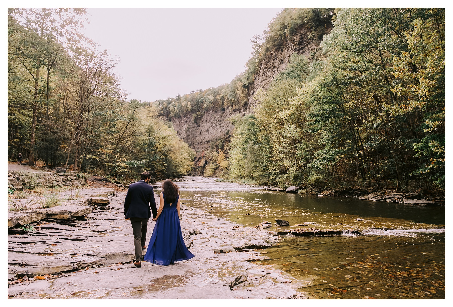 taughannock falls engagement session couple walking away