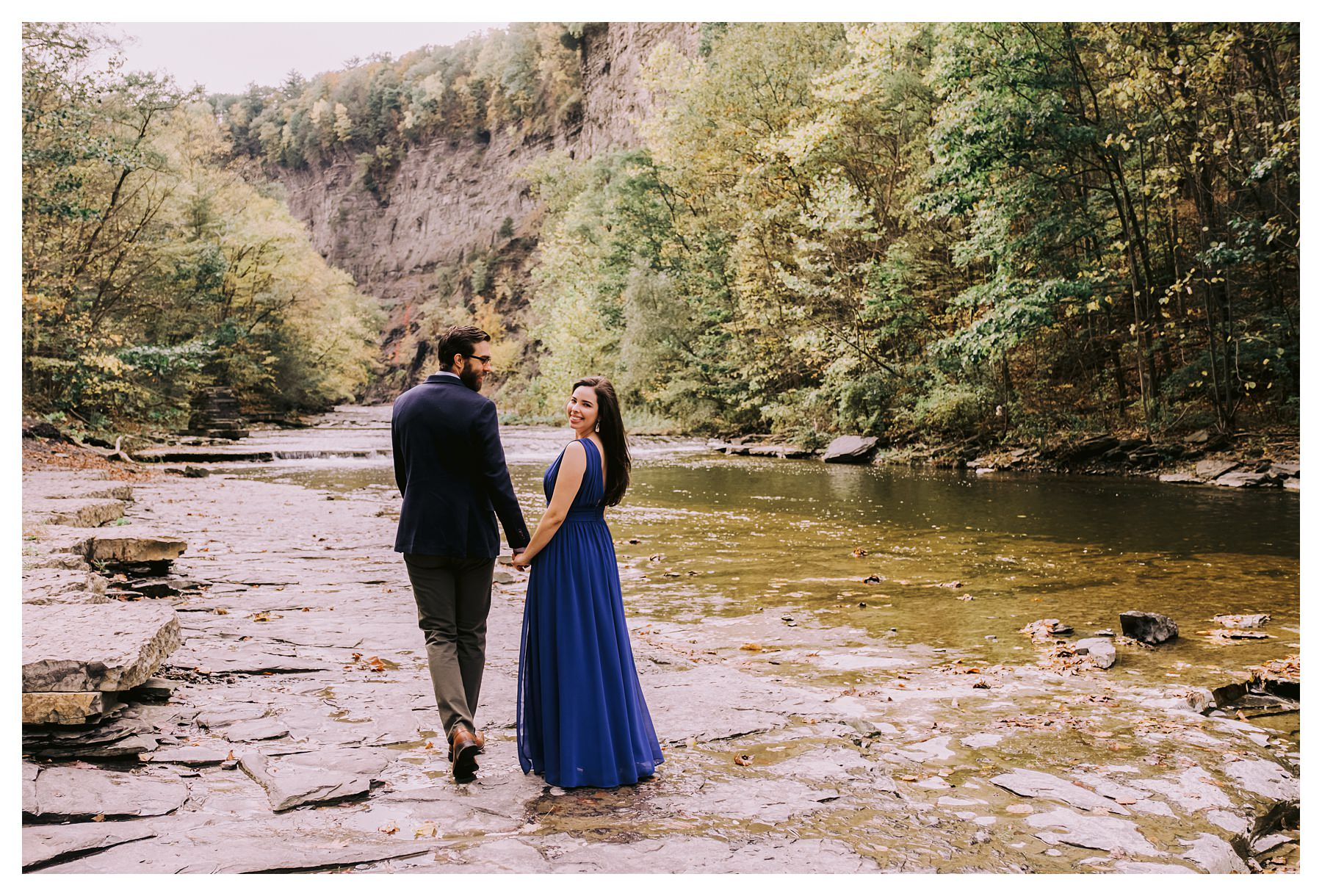 taughannock falls engagement session couple looking back