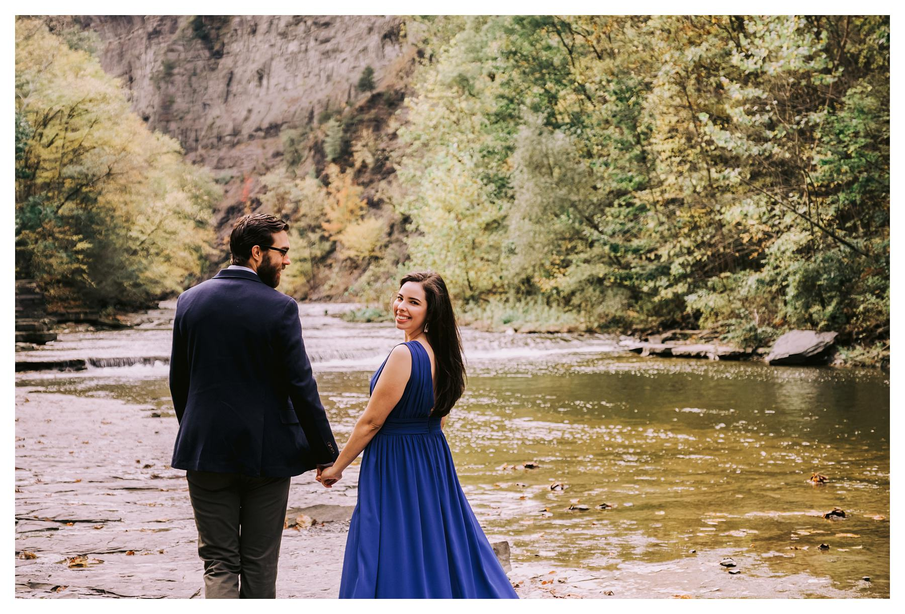 taughannock falls engagement session bride looking back