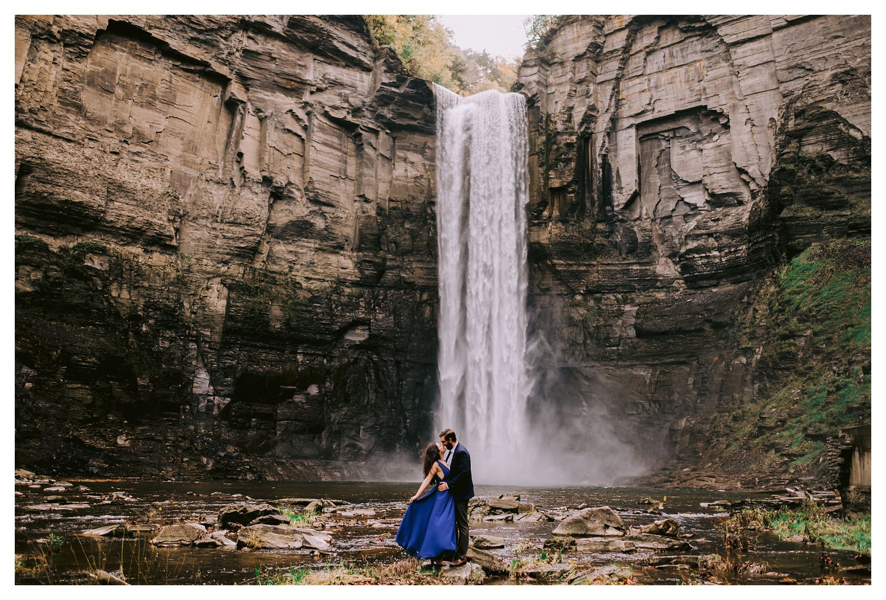 taughannock falls engagement session in front of waterfall